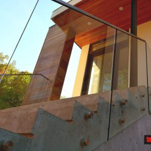 glass railings installation on the concrete stairs